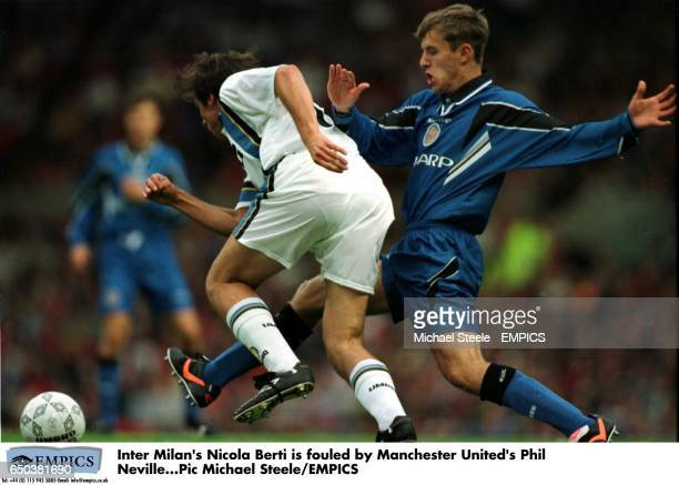 Inter Milan's Nicola Berti is fouled by Manchester United's PhilrNeville