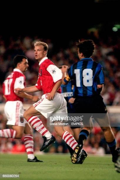 Inter Milan's Nicola Berti keeps an eye on Arsenal's Dennis Bergkamp