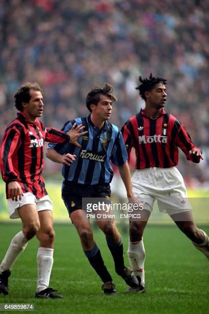 Inter Milan's Nicola Berti with AC MIlan's Franco Barresi and Frank Rijkaard
