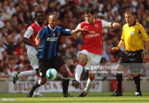 Inter Milan's Olivier Dacourt and Arsenal's Francesc Fabregas battle for the ball