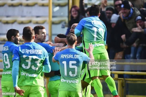 Inter Milan's players celebrate after Brazilian forward Gabriel Barbosa Almeida scored a goal during the Italian Serie A football match Bologna vs...
