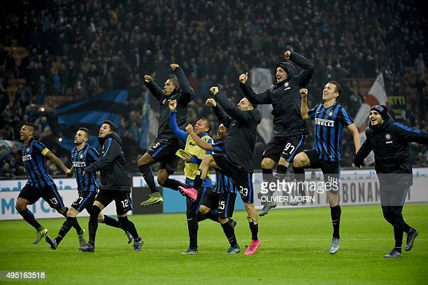 Inter Milan's players celebrate after the Italian Serie A football match Inter Milan vs AS Roma on October 31 2015 at the San Siro Stadium in Milan...