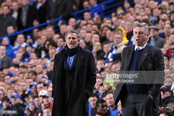 Inter Milan's Portuguese coach Jose Mourinho and Chelsea's Manager Carlo Ancelotti during their second leg in the round of 16 UEFA Champions League...