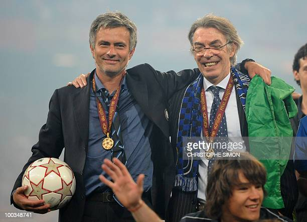 Inter Milan's Portuguese coach Jose Mourinho and Inter Milan's president Massimo Moratti celebrate after winning the UEFA Champions League final...