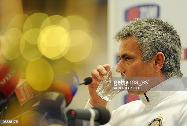 Inter Milan's Portuguese coach Jose Mourinho drinks during a press conference on the eve of Italy's TIM Cup Inter Milan vs AS Roma football match...