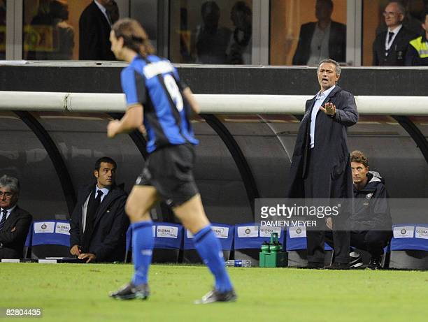 Inter Milan's Portuguese coach Jose Mourinho gives instructions to Inter Milan's Swedish forward Zlatan Ibrahimovic during their Italian Serie A...