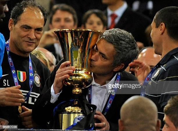 Inter Milan's Portuguese coach Jose Mourinho kisses the Cup after his team defeated AS Roma in the Coppa Italia final on May 5 2010 at Olimpico...