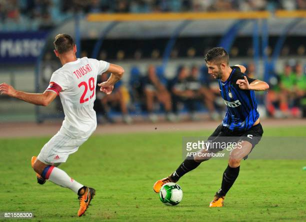 Inter Milan's Roberto Galiardini controls the ball past Lyon's Lucas Tousart during their International Champions Cup football match in Nanjing in...