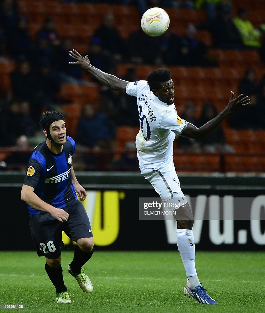 Inter Milan's Romenian defender Cristian Chivu (L) fights for the ball with Tottenham Hotspur's Togolese striker Emmanuel Adebayor during the European Cup football match between Inter Milan and Tottenham, on March 14, 2013 at the San Siro stadium in Milan.