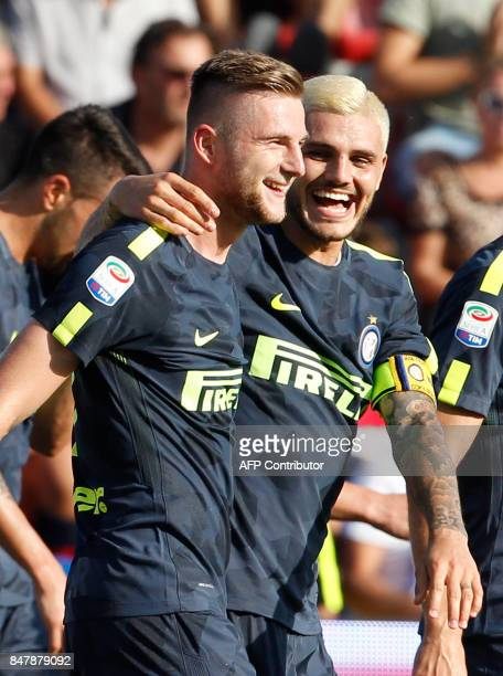 Inter Milan's Slovak defender Milan Skriniar celebrates with his teammate Inter Milan's Argentinian forward Mauro Icardi during the Italian Serie A...