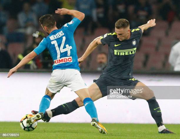 Inter Milan's Slovak defender Milan Skriniar fights for the ball with Napoli's Belgian striker Dries Mertens during the Italian Serie A football...
