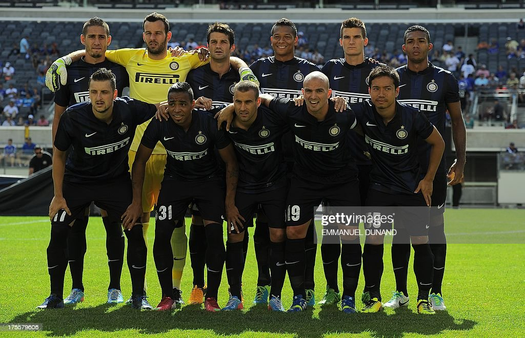 Inter Milan's starting line up pose for a photo before a 2013 International Champions Cup match against Valencia at the MetLife stadium in East Rutherford, New Jersey, on August 4, 2013. AFP PHOTO/Emmanuel Dunand