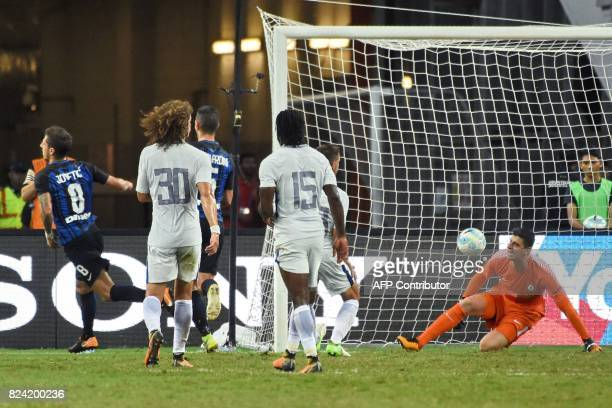 Inter Milan's StevanJovetic celebrates after his first goal against Chelsea during their International Champions Cup football match in Singapore on...