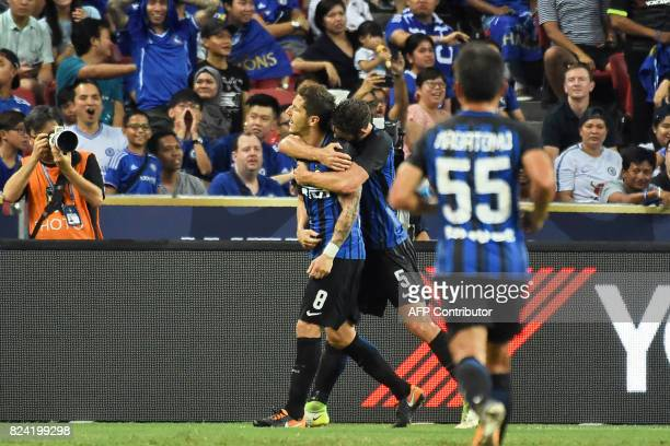 Inter Milan's StevanJovetic celebrates with teammate Roberto Gagliardini after scoring against Chelsea during their International Champions Cup...