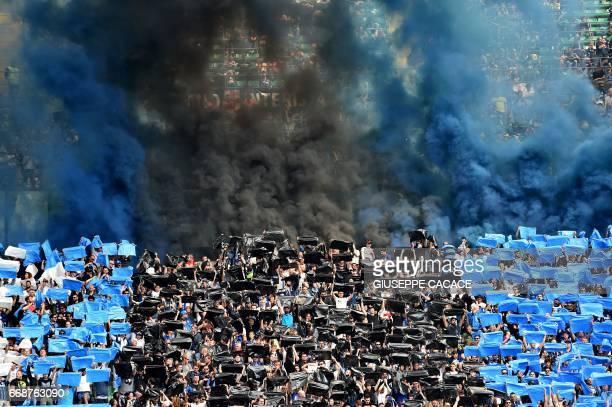 Inter Milan's supporters cheer their team prior the Italian Serie A football match Inter Milan vs AC Milan at the San Siro stadium in Milan on April...