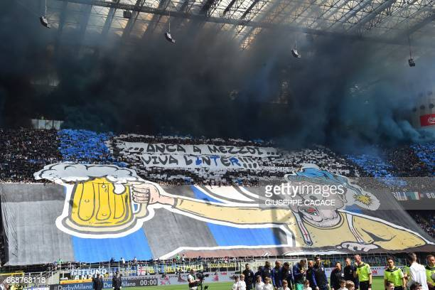 Inter Milan's supporters cheer their team prior the Italian Serie A football match Inter Milan vs AC Milan at the San Siro stadium in Milan on April...