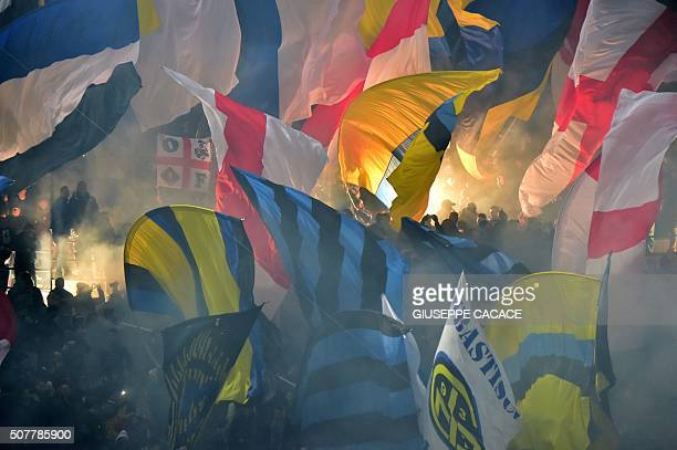 TOPSHOT Inter Milan's supporters wave flags during the Italian Serie A football match between AC Milan and Inter Milan at San Siro Stadium in Milan...
