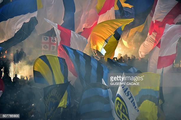 TOPSHOT Inter Milan's supporters wave flags during the Italian Serie A football match between AC Milan and Inter Milan at San Siro Stadium in Milan...