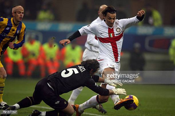 Inter Milan's Swedish forward Zlatan Ibrahimovic challenges for the ball with Parma's goalkeeper Luca Bucci during their 'Serie A' football match...