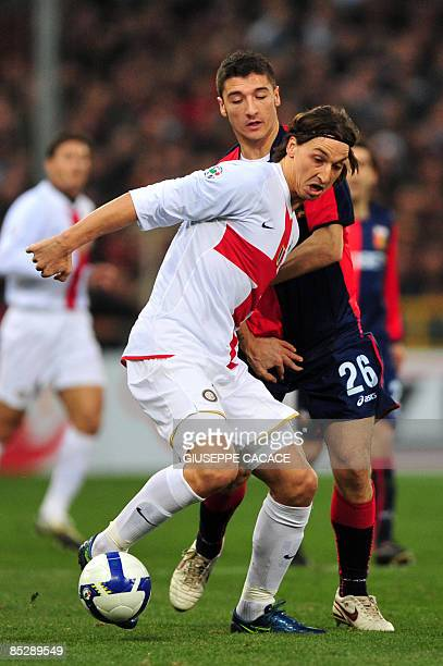 Inter Milan's Swedish forward Zlatan Ibrahimovic challenges for the ball with Genoa's defender Salvatore Bocchetti during their Serie A football...