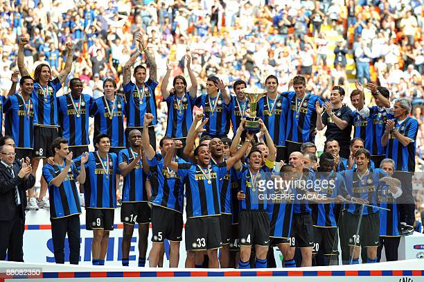 Inter Milan's team celebrate after winning the 17th Italian serie A football championship 'scudetto' at the end of the Serie A football match Inter...