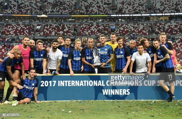 Inter Milan's team poses for photographers after defeating Chelsea FC in their International Champions Cup final football match in Singapore on July...