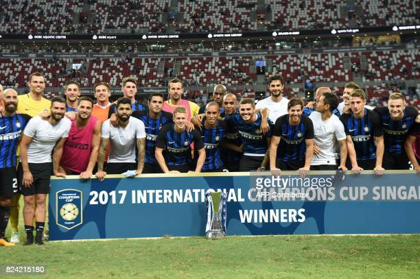 Inter Milan's team poses for photographers after defeating Chelsea FC in their International Champions Cup football match in Singapore on July 29...