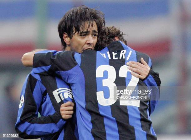 Inter Milan's Urugayan forward Alvaro Recoba is congratulated by teammate Christian Vieiri after he scored the winning goal against Sampdoria during...