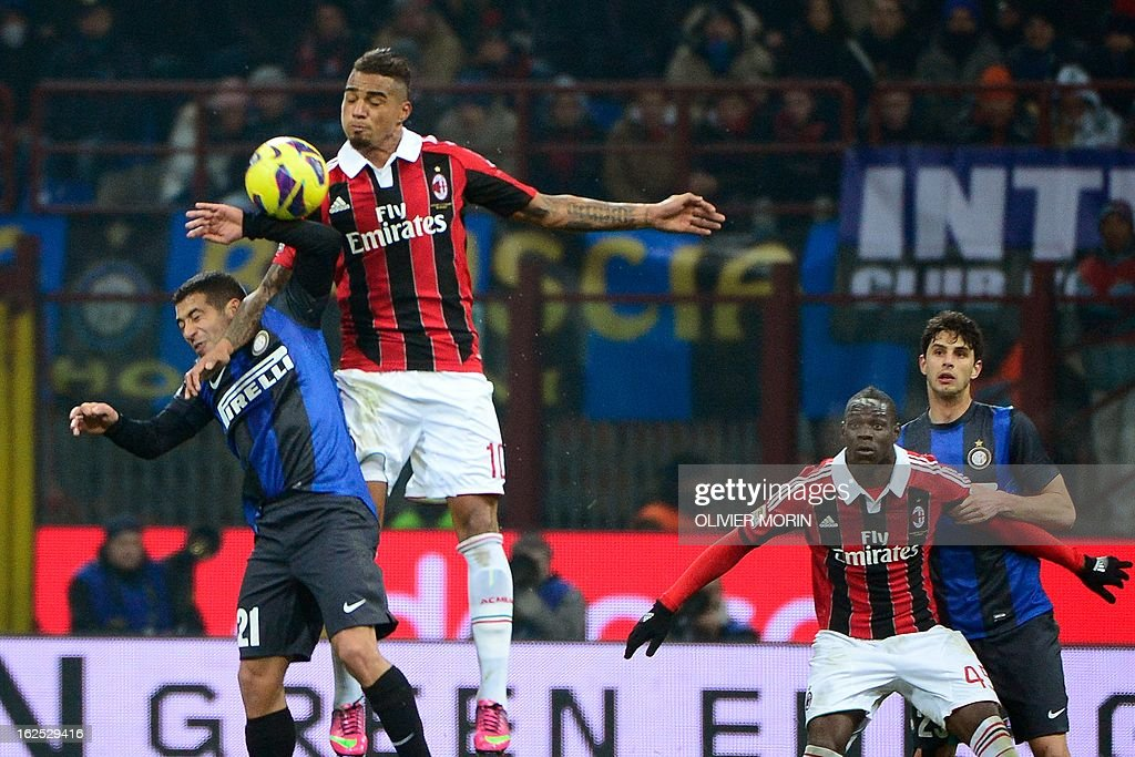 Inter Milan's Uruguajan midfielder Alejandro Walter Gargano (L) fights for the ball with AC Milan's Ghanaian defender Prince Kevin Boateng during the serie A match between Inter MIlan and AC Milan on February 24, 2013 in Milan, at the San Siro stadium. AFP PHOTO / OLIVIER MORIN