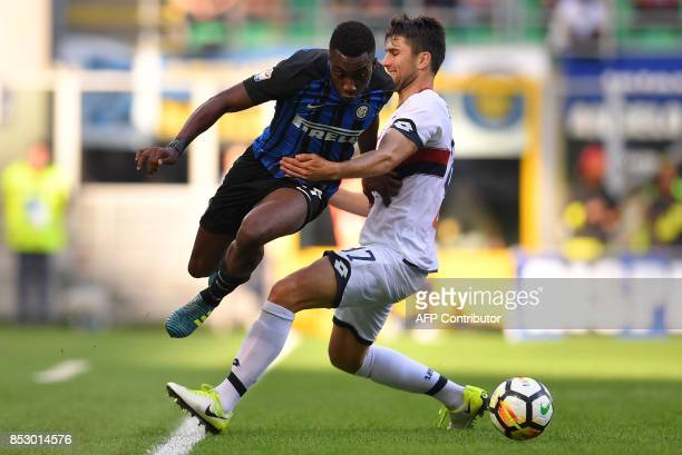 Inter Milan's Yann Karamoh vies with Genoa's Bosnian defender Ervin Zukanovic during the Italian Serie A football match Inter Milan Vs Genoa on...