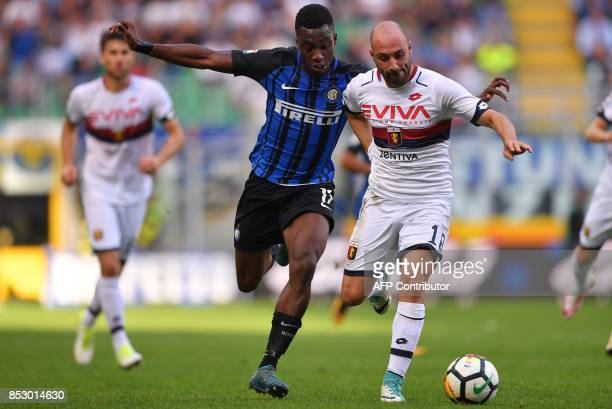 Inter Milan's Yann Karamoh vies with Genoa's defender Francesco Migliore during the Italian Serie A football match Inter Milan Vs Genoa on September...