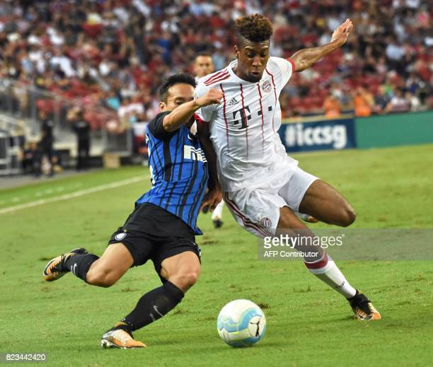 Inter Milan's Yuto Nagatomo fights for the ball with Bayern Munich's Kingsley Coman during their International Champions Cup football match in...