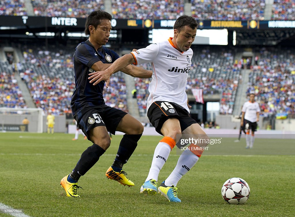Inter Milan's Yuto Nangatomo (L) and Valencia's Javier Fuego battle for the ball during a 2013 International Champions Cup match on August 4, 2013 at the MetLife stadium in East Rutherford, New Jersey. AFP PHOTO/Don Emmert
