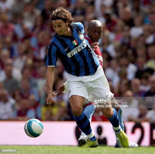 Inter Milan's Zlatan Ibrahimovic and Aston Villa's Nigel ReoCoker battle for the ball