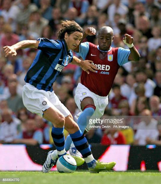 Inter Milan's Zlatan Ibrahimovic and Aston Villa's Nigel ReoCoker battle fot the ball during a Pre Season Friendly at Villa Park Birmingham