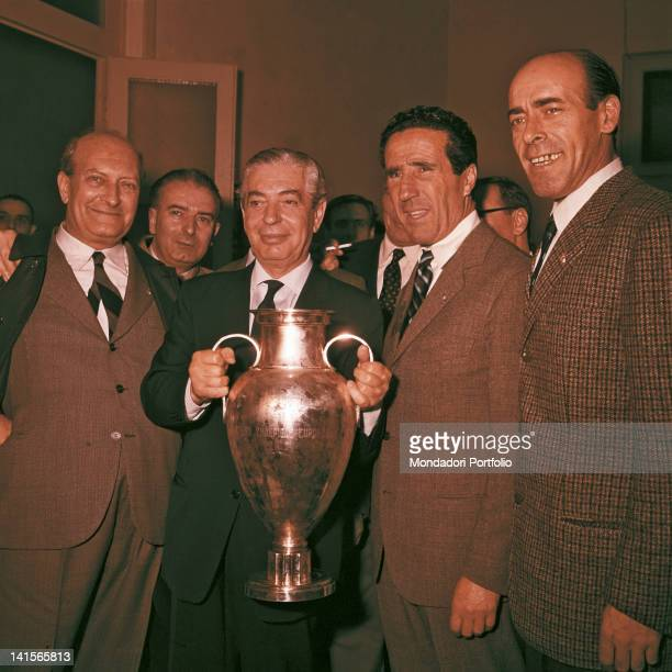 Inter President Angelo Moratti and coach Helenio Herrera surrounded by some fans of the team are celebrating the victory of the European Cup final...