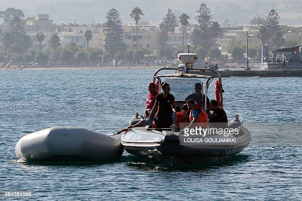 Intercepted migrants arrive aboard of a coast guard boat to the port of Kos island on August 18 2015 Authorities on the island of Kos have been so...