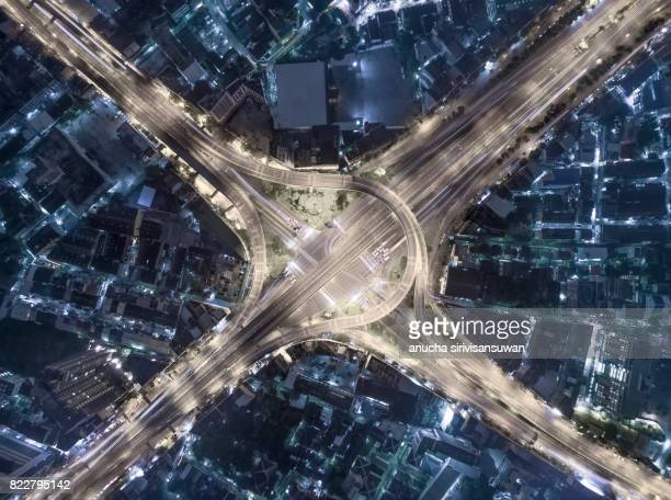 interchange Highway traffic beautiful at Night, Bird Eye View in bangkok , top view , Bangkok , Thailand .