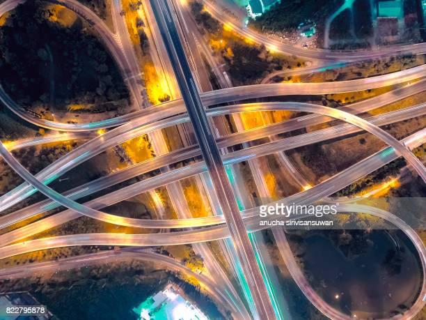 interchange Highway traffic beautiful at Night, Bird Eye View in bangkok , top view , Bangkok , Thailand .