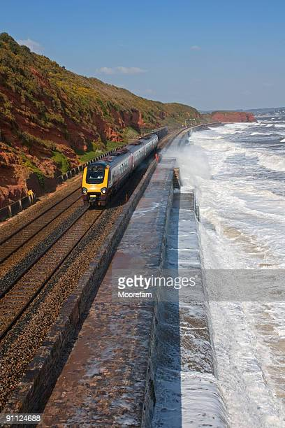Intercity and goods trains near Dawlish in a storm