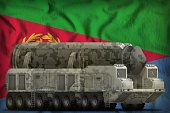 intercontinental ballistic missile with city camouflage on the Eritrea flag background. 3d Illustration