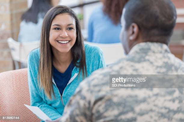 Interested student talks with military officer at recruitment office