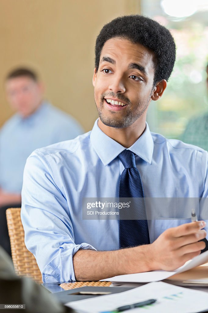Interested young adult male at a job interview