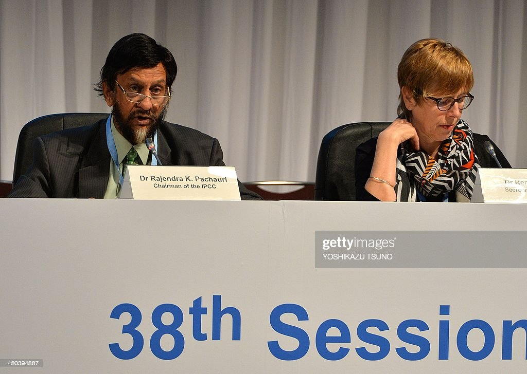 Intergovernmental Panel on Climate Change (IPCC) chairman Rajendra Pachauri (L) delivers a speech was Renate Christ (R), secretary of IPCC listens at the opening session of the 10th plenary of the IPCC Working Group II in Yokohama, suburban Tokyo on March 25, 2014. International scientists gathered near Tokyo for a week-long meeting centred on a grim climate change report that warned of floods and drought that could stoke conflicts and wreak havoc on the global economy. AFP PHOTO / Yoshikazu TSUNO