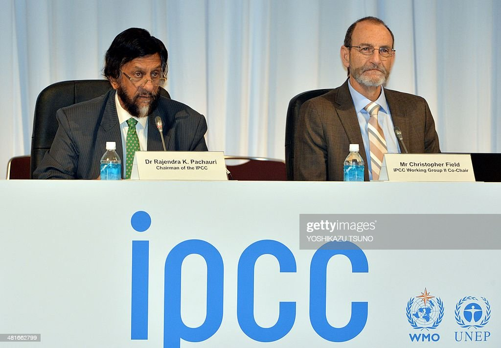 Intergovernmental Panel on Climate Change (IPCC) chairman Rajendra Pachauri (L) delivers a speech while IPCC Working Group II co-chairman Chris Field (R) looks on at a press conference after the 10th plenary of the IPCC Working Group II in Yokohama, suburban Tokyo on March 31, 2014. Soaring carbon emissions will amplify the risk of conflict, hunger, floods and migration this century, the UN's expert panel said in a landmark report on the impact of climate change. AFP PHOTO / Yoshikazu TSUNO