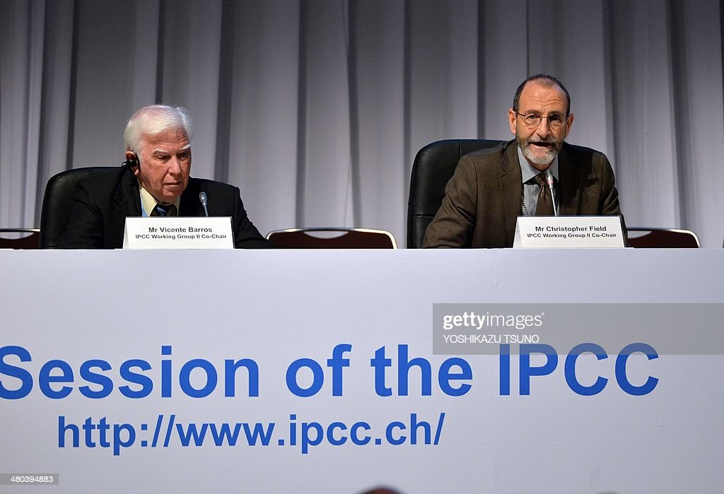 Intergovernmental Panel on Climate Change (IPCC) Working Group II co-chairman Chris Field (R) delivers a speech as co-chairman Vicente Barros (L) looks on at the opening session of the 10th plenary of the IPCC Working Group II in Yokohama, suburban Tokyo on March 25, 2014. International scientists gathered near Tokyo for a week-long meeting centred on a grim climate change report that warned of floods and drought that could stoke conflicts and wreak havoc on the global economy. AFP PHOTO / Yoshikazu TSUNO