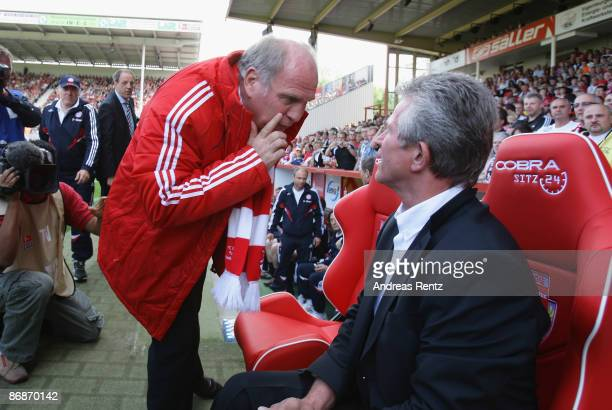 Interim coach Jupp Heynckes speaks to manager Uli Hoeness of Bayern prior to the match during the Bundesliga match between FC Energie Cottbus and...