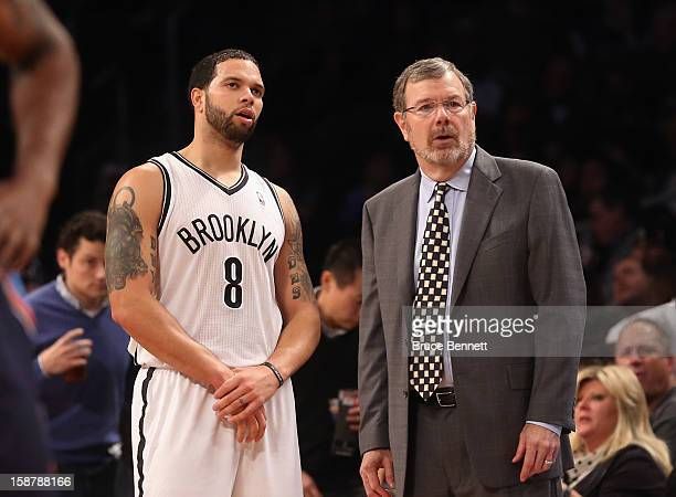 Interim Coach PJ Carlesimo of the Brooklyn Nets and Deron Williams wait for play to begin in their game against the Charlotte Bobcats at the Barclays...