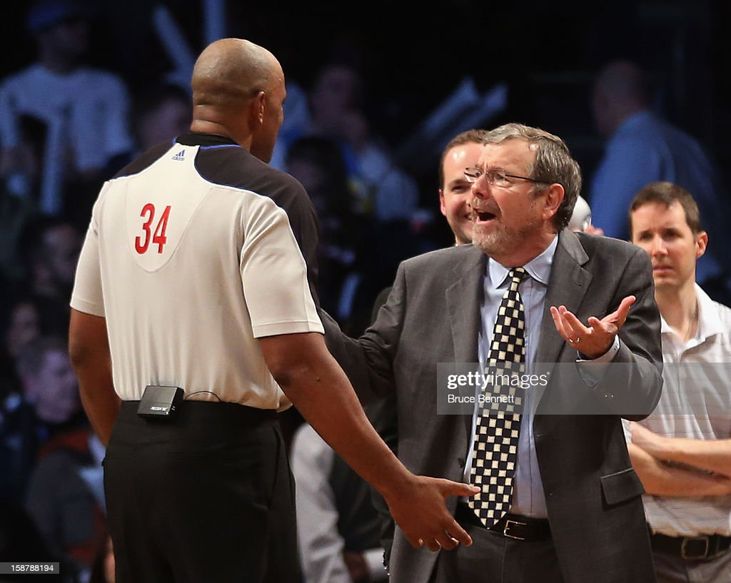 Interim Coach PJ Carlesimo of the Brooklyn Nets argues with referee Kevin Cutler in the game against the Charlotte Bobcats at the Barclays Center on...