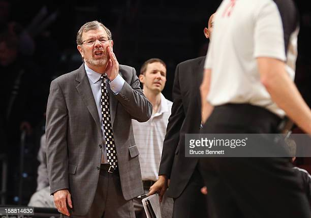Interim Coach PJ Carlesimo of the Brooklyn Nets argues with referee in the game against the Charlotte Bobcats at the Barclays Center on December 28...
